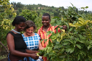 Harriet Lamb of Fairtrade International in Rwanda with Fairtrade coffee farmers